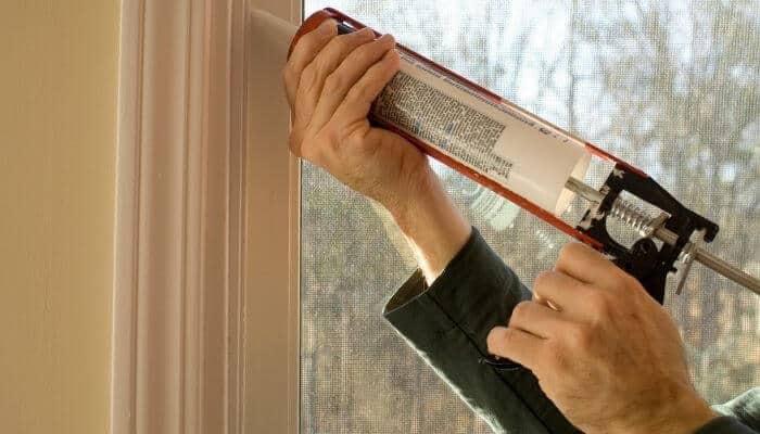 caulking a door window